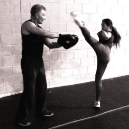High roundhouse kickboxing kick