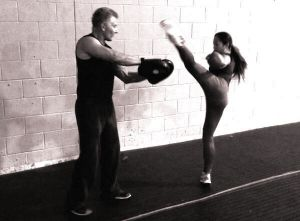 High roundhouse kickboxing kick