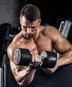 Strength Training with dumbbell weight performing a curl