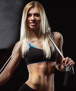 image of fitness girl with a jump rope around her neck