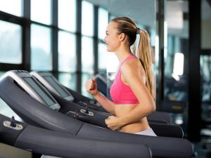 Fitness Girl on Treadmill for cardio training