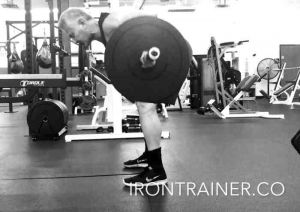 personal trainer demonstrating a bent over barbell row