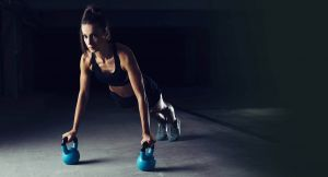 female performing a Kettlebell push up