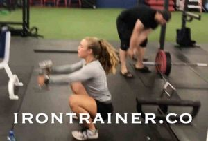 Fitness Trainer Performing Jump Squats