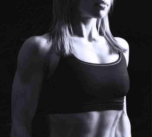 Female Fitness Trainer just standing in workout clothing