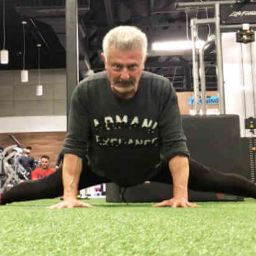Personal Trainer demonstrating some carious dynamic Stretching techniques