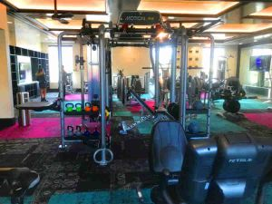 workout station with pull up bar olympic bar sit up bench and cables