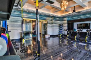 apartment gym with spinning bikes and TRX bands