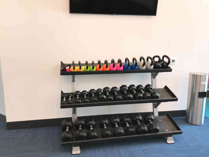 dumbbell rack with kettlebells and dumbbells