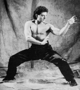 man in martial arts horse stance with hands in tiger claw position