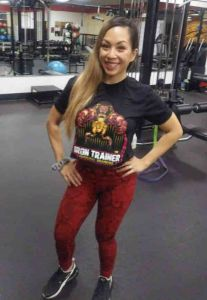 female wearing iron trainer t shirt in black with logo