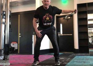 personal trainer using cable equipment at elysian apartment gym in summerlin nv