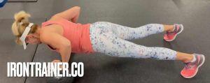 female performing push ups correctly on two slam balls