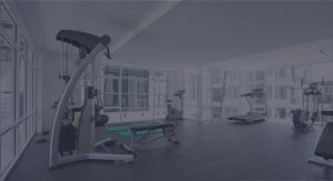 cardio machines and weight equipment in modern room photo