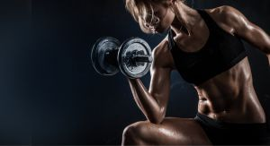 girl performing a dumbbell curl seated with elbow on thigh